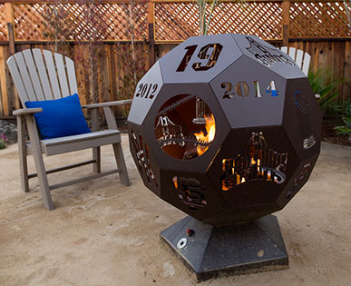 baseball themed custom fire pit installed by landscape designer in Morgan Hill