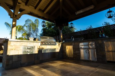 custom outdoor kitchen with all the appliances needed