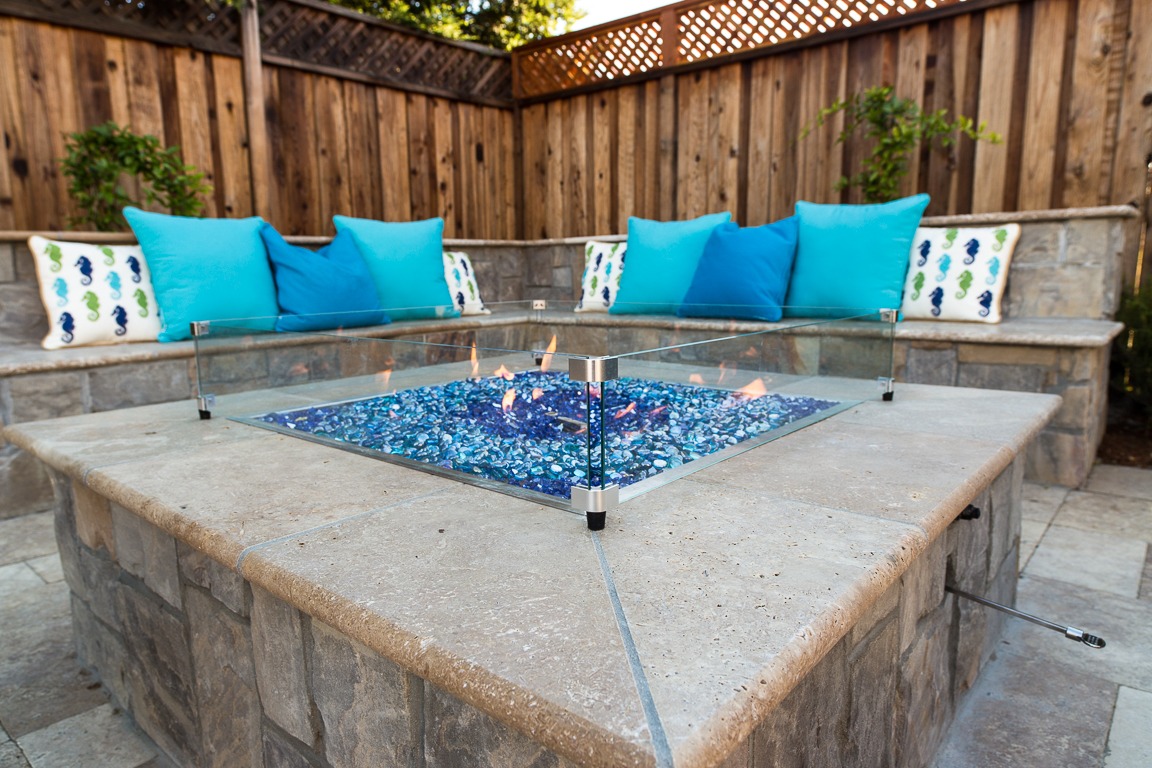 Custom natural stone fire pit installed by Morgan Hill landscape design contractor