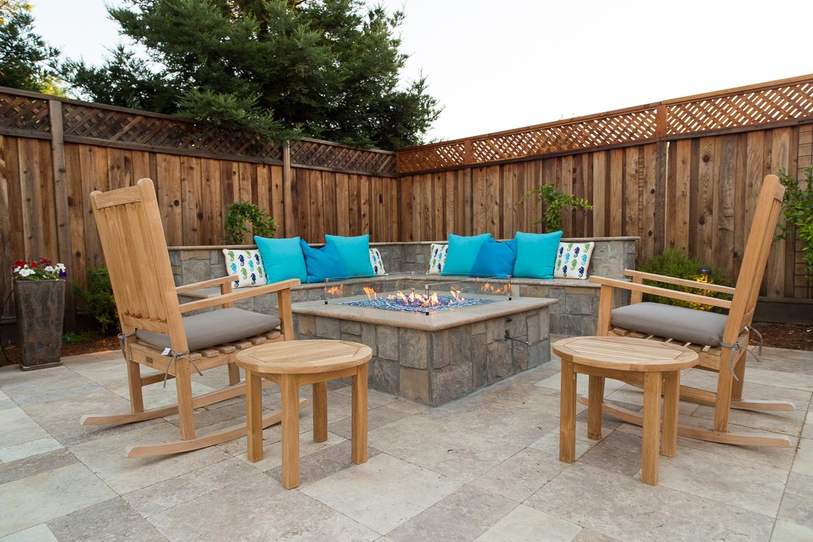 custom stone fire pit with stone bench