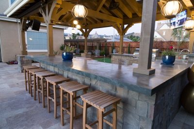 custom outdoor kitchen with interlocking stones
