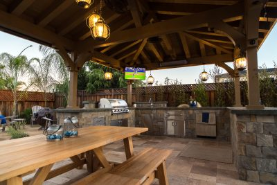 custom outdoor kitchen with bench