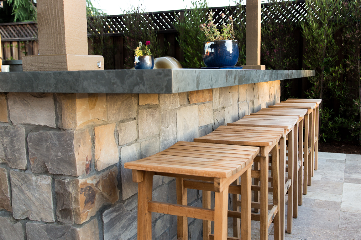 custom stone bar with chairs