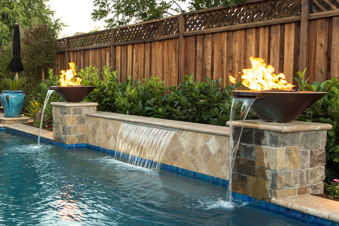 swimming pool with and fire fountain