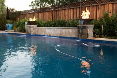 custom fire fountain near swimming pool