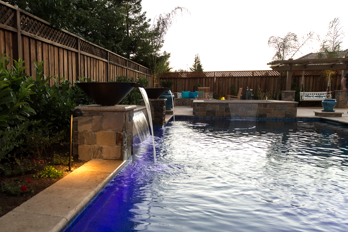 swimming pool with custom fire fountain