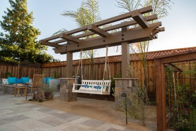 custom fencing with pergola and swing