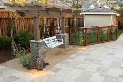 stone walkway with swing and pergola