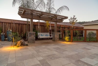 custom garden with stone walkway and pergola
