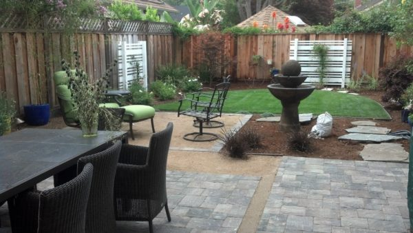 Landscape design in San Jose including natural stone patio, new fence, lawn, wood accents, and fountain