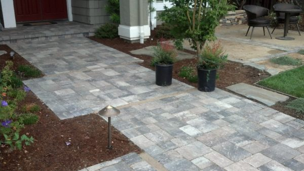 custom stone walkway with flower pots