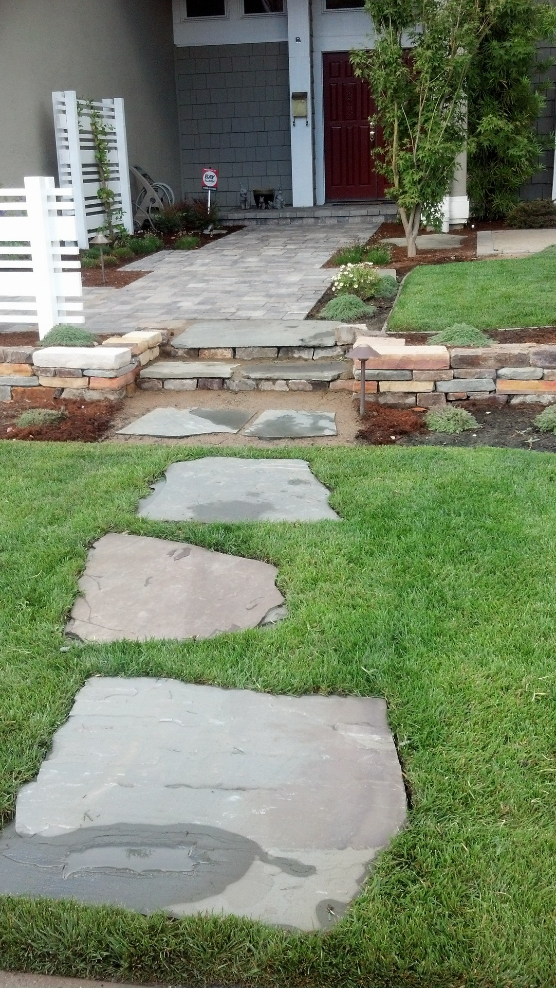 custom stone walkway on lawn