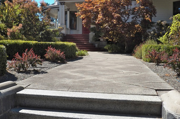 stone walkway and front yard landscape design