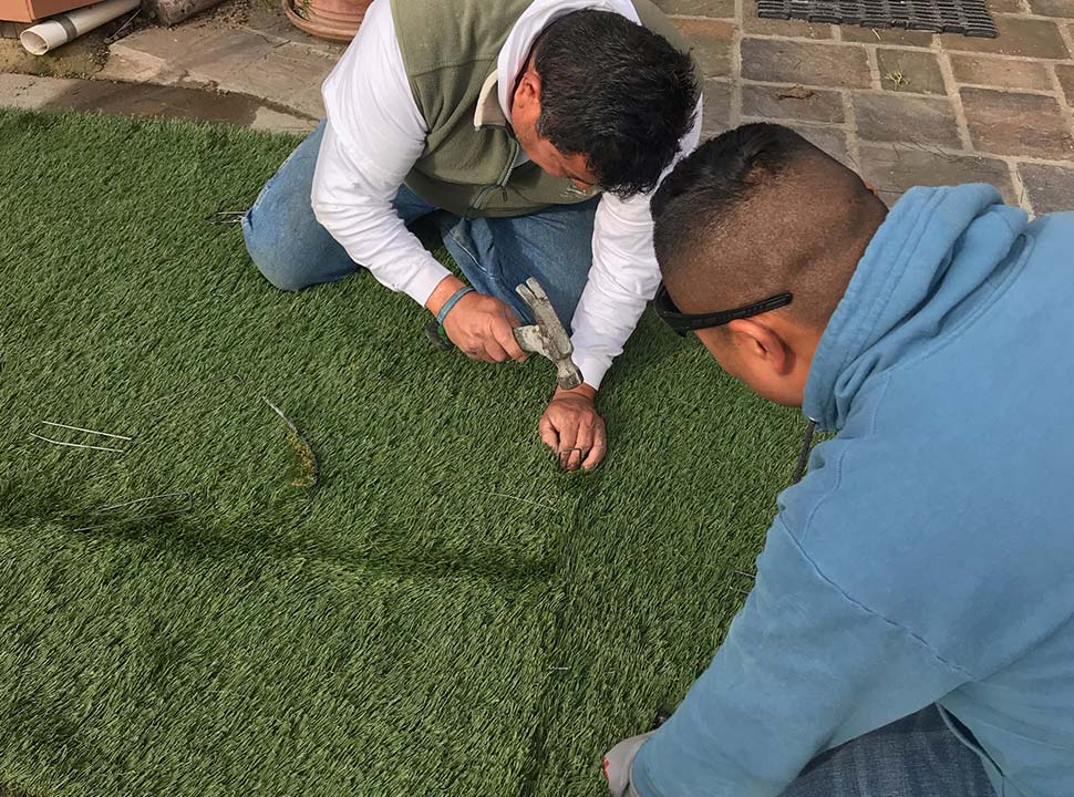 our pros are working on a turf installation