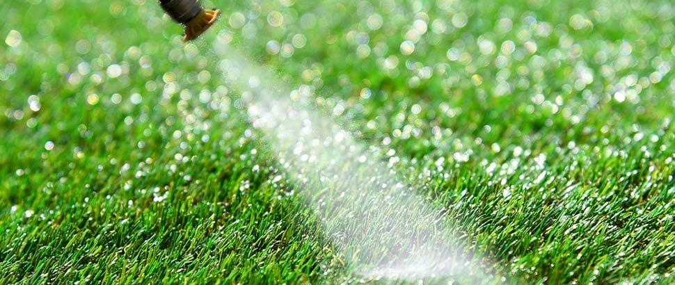 can you power wash artificial grass?